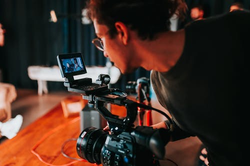 image of a film crew working hard