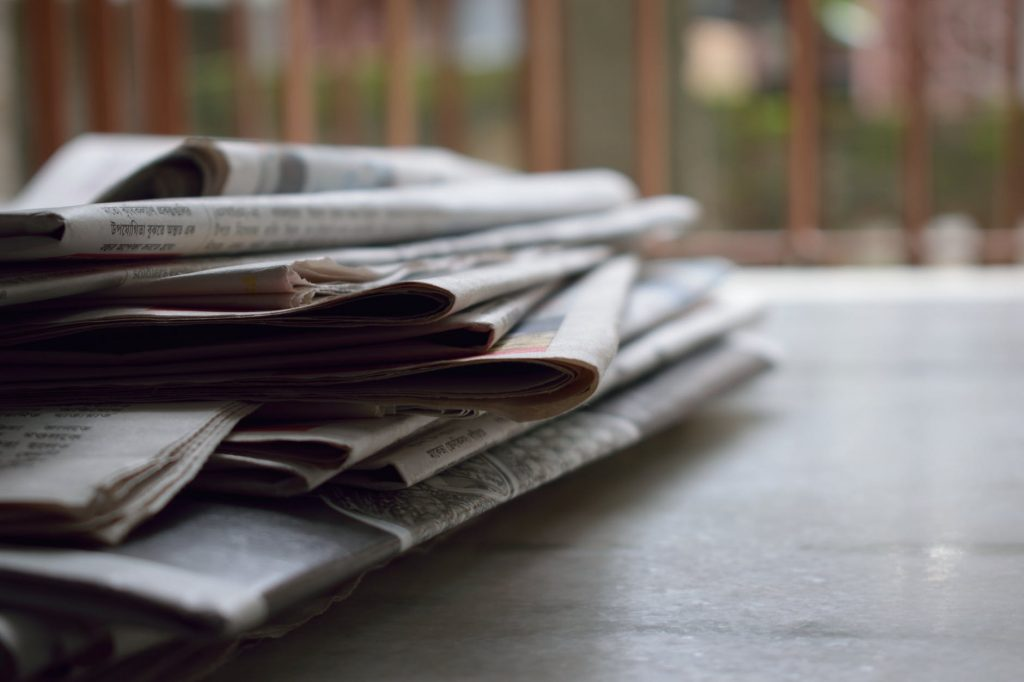 image of newspapers in support of journalism requests